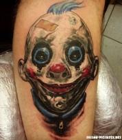 horrible-scary-clown-face-tattoo-on-men-leg